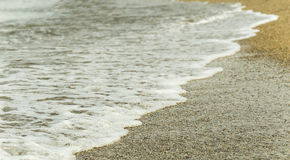 Onde della schiuma della spiaggia Fotografie Stock Libere da Diritti