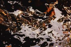 Onde di acqua astratte dell'oro con il reflectio Fotografia Stock Libera da Diritti