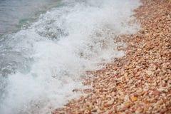 Onde et caillou de mer Composition normale de vecteur Photo libre de droits
