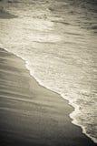 Onde et sable Photos libres de droits
