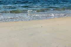 Onde et sable Photographie stock