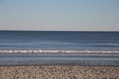 Onde sulla spiaggia Immagine Stock