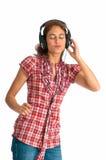 Ondeggiando alla musica con le cuffie sopra Immagine Stock Libera da Diritti