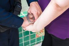 Onder arrestatie Stock Afbeeldingen