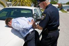 Onder Arrestatie Stock Fotografie