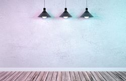 Ondergrondse toonzaal met drie hangende metaallampen Royalty-vrije Stock Afbeelding