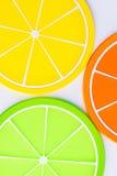 Onderleggers voor glazen in de vorm van oranje plakken Royalty-vrije Stock Fotografie