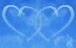 Onderling verbindende Harten Skywriting Royalty-vrije Stock Foto