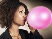 Onderneemster Blowing Up Balloon royalty-vrije stock foto's