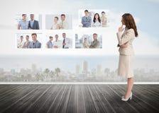 Onderneemster die bij futuristische interface staren royalty-vrije stock foto
