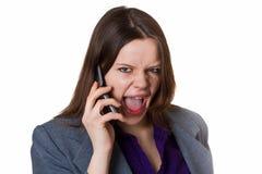 Onderneemster die in de telefoon gilt Stock Fotografie