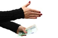 Onderneemster die handdruk met geld aanbieden royalty-vrije stock foto's