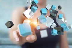 Onderneemster die het drijven blauwe glanzende 3D renderin van het kubusnetwerk gebruiken Stock Afbeelding