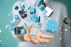 Onderneemster die het drijven blauwe glanzende 3D renderin van het kubusnetwerk gebruiken Royalty-vrije Stock Foto
