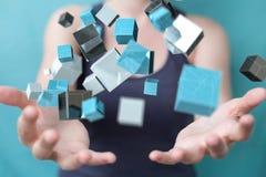 Onderneemster die het drijven blauwe glanzende 3D renderin van het kubusnetwerk gebruiken Stock Foto