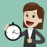 Onderneemster of manager de greepklok en neemt controle op zijn tijd Stock Fotografie