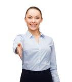 Onderneemster met geopende hand klaar voor handdruk Stock Foto's