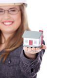 Onderneemster met huiswijze Stock Foto's