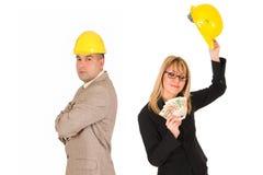 Onderneemster met inkomens en zakenman stock foto