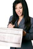 Onderneemster met krant stock foto's