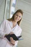 Onderneemster Writing In Planner royalty-vrije stock foto's