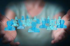 Onderneemsterholding en wat betreft 3D teruggevende groep blauwe pe Stock Afbeelding