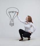 Onderneemstertekening en ideelamp op royalty-vrije stock foto