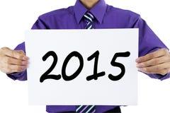 Ondernemersholding nummer 2015 op een document Stock Fotografie