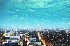 Onderwatermening over stad Stock Foto