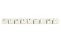 Onderwijs van verspreide toetsenbordsleutels op wit Stock Fotografie