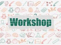 Onderwijsconcept: Workshop over muurachtergrond Stock Foto
