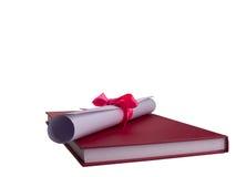 Onderwijsdiploma, Rood boek Knippende weg stock foto