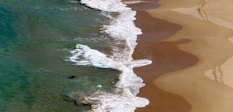Ondes cassées le sable Images stock