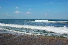 Ondes et sable Photographie stock libre de droits