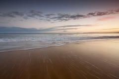 Ondes sur une plage Image stock