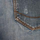 ondiepe DOF De textuur van jeans Fragment van jeansbroeken stock foto