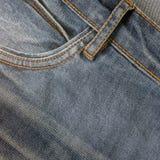 ondiepe DOF De textuur van jeans Fragment van jeansbroeken stock fotografie