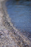Ondiepe DOF op zand en overzees Stock Afbeeldingen