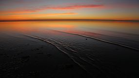 Ondinhas do nascer do sol Imagem de Stock Royalty Free
