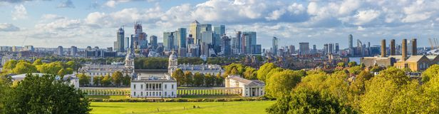 Ondon, England, Panoramic Skyline View Of Greenwich College and. London, England, Panoramic Skyline View Of Greenwich College and Canary Wharf At Golden Hour stock images