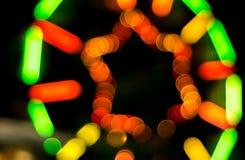 Onduidelijk beeldlicht van de achtergrond van het ferriswiel Stock Foto