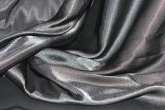 Ondulando dobras da tela da seda cinzenta Imagens de Stock