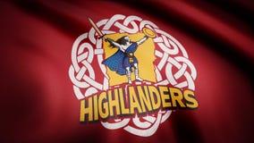 Ondulant dans le drapeau de vent avec le symbole de l'équipe de rugby les montagnards Concept de sports Utilisation éditoriale se photographie stock libre de droits