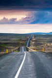 Ondulated and empty road in the sub-artic icelandic landscape Stock Images