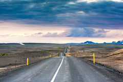 Ondulated and empty road in the sub-artic icelandic landscape Royalty Free Stock Photo