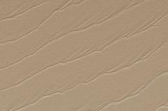 Ondulations de sable d'effet d'art sur une plage Photographie stock