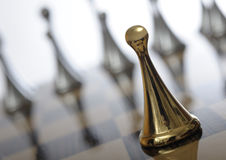Shiny golden chess pawn Stock Photo
