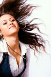 One active woman with long hair in motion. Active young woman with moving hair Royalty Free Stock Images