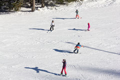 One adult and four children  enjoying good snow. JASNA, SLOVAKIA - February 12: One adult and four children  enjoying good snow on slopes of the best ski resort Stock Image