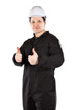 Handyman wearing uniform and hardhat Royalty Free Stock Images